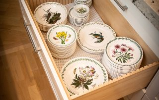 fine china in a kitchen drawer