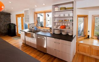 open cabinets holding plates and other kitchenware