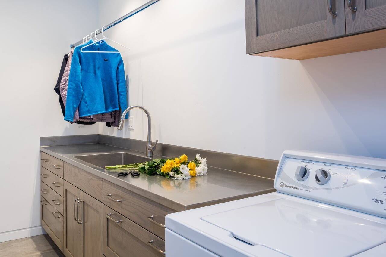 laundry room with flowers on the counter